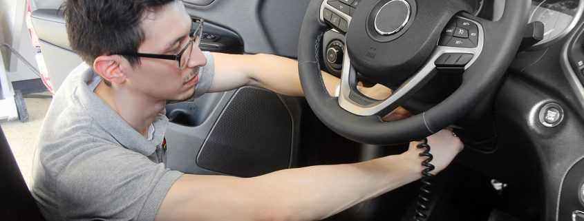 Smart Start Technician Installing an Interlock Device in car
