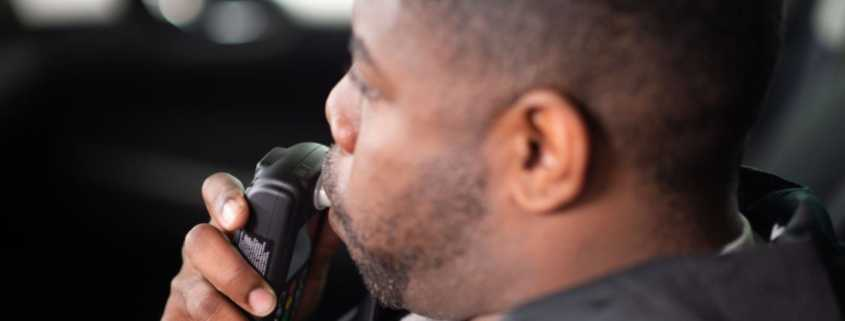 driver blows into ignition interlock device