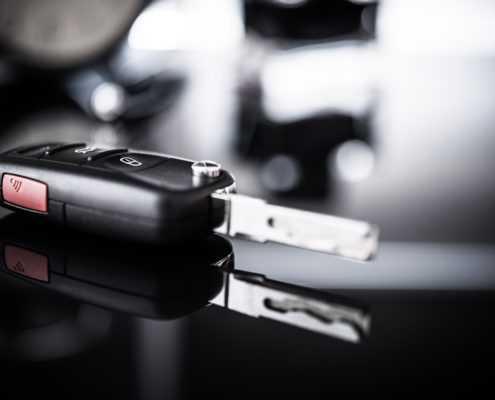 Car keys closeup and a driving concept