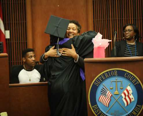 Drug Court Graduation with Graduate Hugging Judge