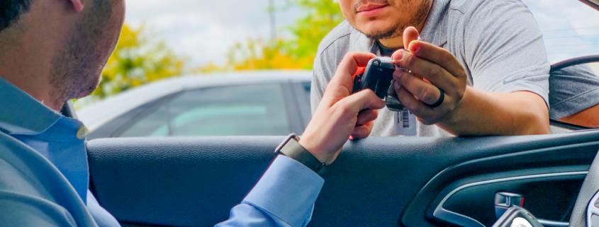 Smart Start Ignition Interlock Client Handed Over Car Keys from Technician