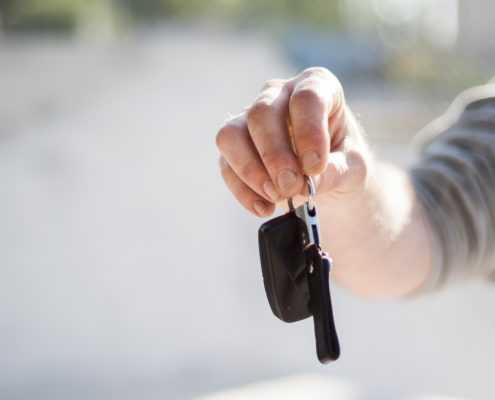 male holding car keys