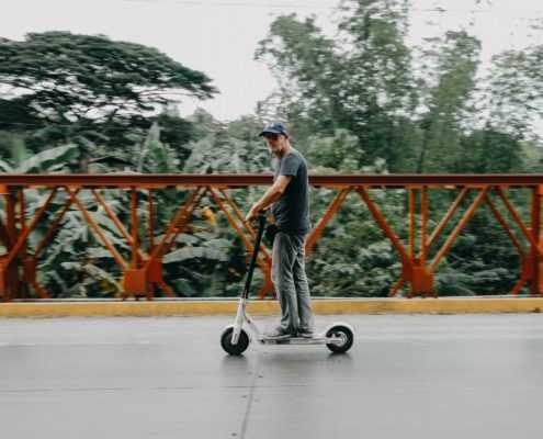 Man riding on electric scooter