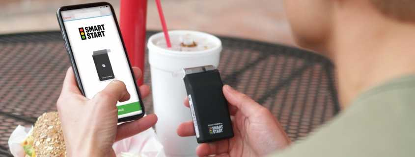 A client uses Smart Start's BreathCheck to check their breath alcohol concentration.