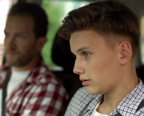 Teen driver talks with father