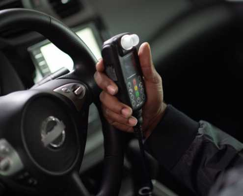 Client gets ready to blow into Smart Start Ignition Interlock Device