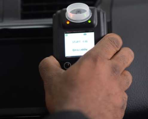 Driver reaching for Smart Start Ignition Interlock Device
