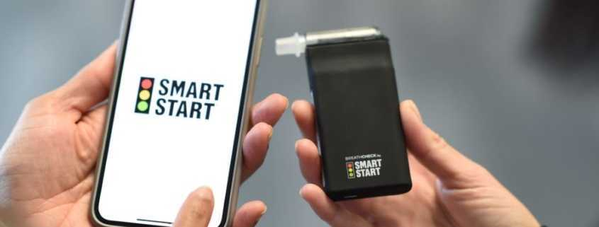BreathCheck portable breath alcohol monitoring device along with a smartphone