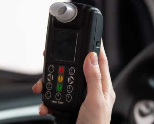 Woman holding a Smart Start Ignition Interlock Device